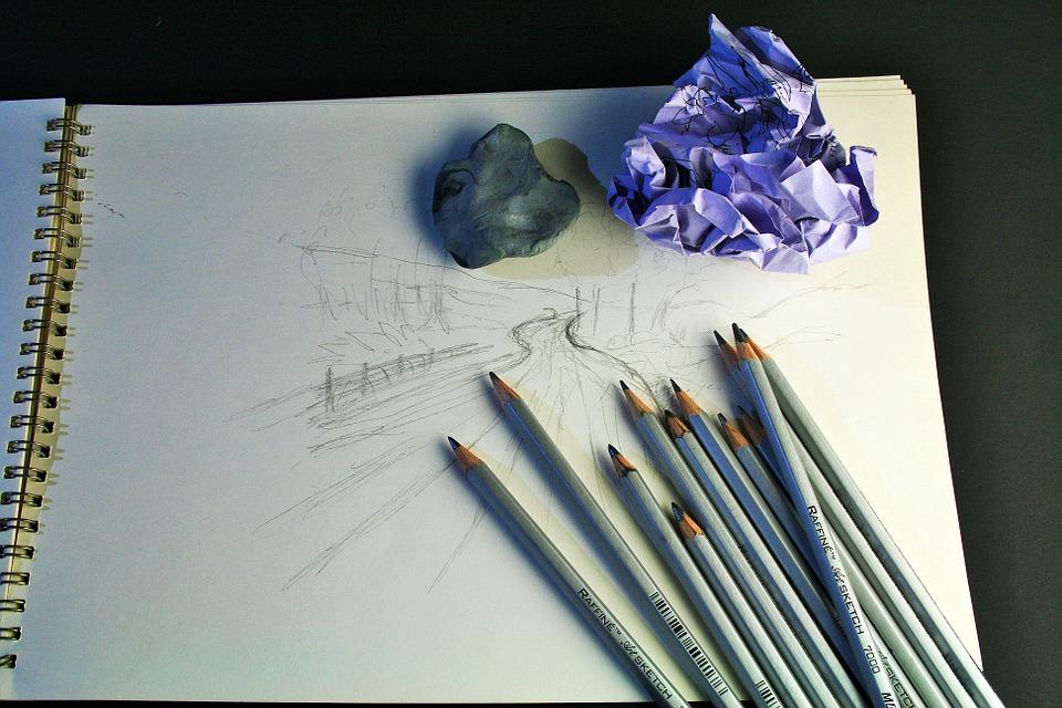 scribbling down ideas in a sketch pad