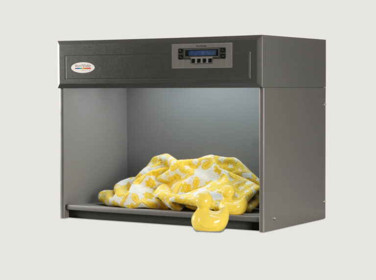 Yellow duck and towel in colour assessment cabinet
